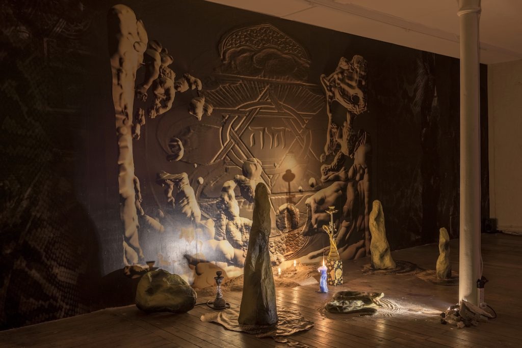 TETRAGRAMMATON Digital prints, spotlights, rubber snake, hookah pipes, sand, spell 2016, dimensions variable (installed at LD50 gallery, London) www.joeyholder.com/tetragrammaton photo: Damian Griffiths